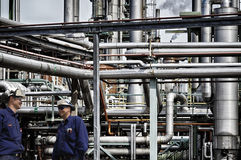Oil and gas workers inside refinery Stock Images