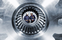 Oil and gas workers with pipelines Stock Photo