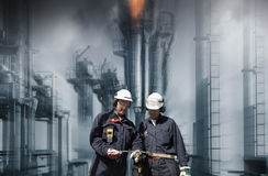 Oil and gas workers with refinery industry Royalty Free Stock Image