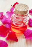 Oil in glass bottle and rose petals Stock Photography