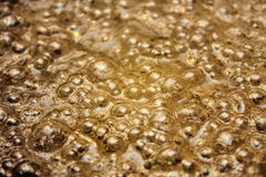 Oil golden bubbles Royalty Free Stock Photo