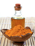 Oil and grinded turmeric Royalty Free Stock Images