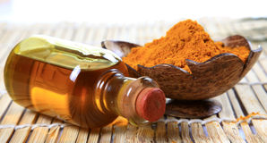 Oil and grinded turmeric Royalty Free Stock Photos