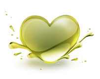 Oil heart. Olive oil in the shape of heart on a white background Royalty Free Stock Photo