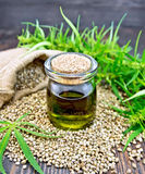 Oil hemp with seed on board Stock Images