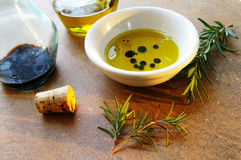 Oil and herbs Stock Photography