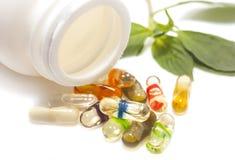 Oil  herbs capsul on isolate. Alternative medicine Royalty Free Stock Photo