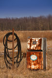Oil Heritage vertical. On the Oil Heritage road an old rusty gas pump sits abandoned in a field.  Could be used to demonstrate new energy alternatives and peak Royalty Free Stock Photos