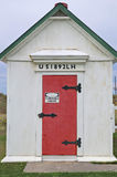 Oil House at Dungeness Lighthouse - Red door. The Oil House at the Lighthouse at Dungeness Spit near Sequim Washington state. Fuel oil used by the lighthouse in Royalty Free Stock Images