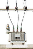 Oil immersed transformer. Three phase conservator type oil immersed transformer on concrete platform, isolated on white background Royalty Free Stock Photo