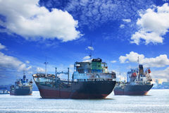 Oil and industrial tanker transport ship floating on river port Stock Photos
