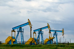 Oil industry equipment on cloudy sky Royalty Free Stock Photography