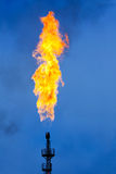 Oil Industry: Flare Stack. Oil Industry: Huge Flare Stack in the Blue Evening Sky Stock Photo
