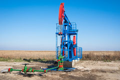Oil industry pump jack close up Royalty Free Stock Image