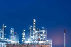 Oil Industry Refinery factory at Sunset, Petroleum Stock Photos