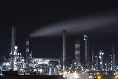 OIL INDUSTRY REFINERY PETROL FACTORY IN NIGHT LIGHT. VIENNA AUSTRIA stock photos