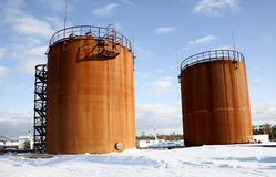 Oil industry. Tank storage crude Oil in winter landscape Stock Photos