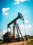Oil industry. Well pumps in field Stock Images