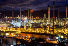 Oil indutry refinery in petrochemical plant at sunset. Petrochemicals are chemical products derived from petroleum. Some chemical compounds made from petroleum Royalty Free Stock Images