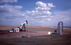 Oil jackpump. Working jack-pump in the oil patch of North Dakota Royalty Free Stock Image