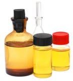Oil jars over white background Stock Photos