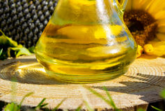 Oil in jars and sunflower Royalty Free Stock Photos