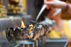 Oil lamp. To oil pour the lamp at Doi Sudhep in Thailand Stock Images