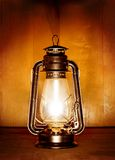 Oil lamp. Old oil lamp light over wood plank background Royalty Free Stock Image