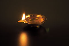 Oil lamp. Lighted in the dark Royalty Free Stock Image