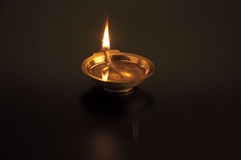 Oil lamp. Lighted in the dark Stock Photos
