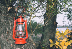 Oil lamp in an autumn garden Royalty Free Stock Image