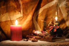 Oil lamp, candle and an old book Royalty Free Stock Photography