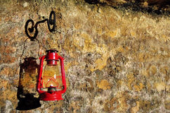 Oil lamp on a cave wall Royalty Free Stock Photography