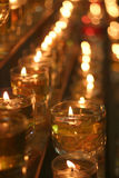 Oil Lamp in the dark. Rows of oil lamp placed inside a temple during Wesak Day, a buddhism event every year Stock Image