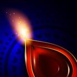 Oil lamp with diwali diya elements over dark background Stock Photo