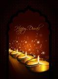 Oil lamp with diwali diya greetings dark background Stock Photo