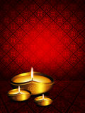 Oil lamp with diwali greetings over dark background Stock Photography