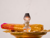 Oil lamp and joss sticks at temple in Thailand Royalty Free Stock Images