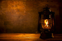 Oil Lamp. Lighting a Wood Background Stock Images