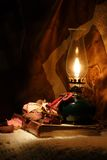 Oil lamp and an old book Royalty Free Stock Photo