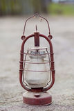 Oil lamp. Old dusty kerosene lamp standing on the ground Stock Images