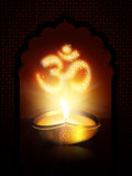 Oil lamp with om sign over dark background Stock Images