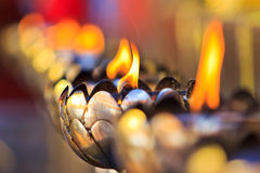 Oil lamp. People fill oil in the oil lamp at the temple Stock Image