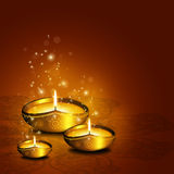 Oil lamp with plac for diwali greetings over dark background. Oil lamp with place for diwali greetings over gold background