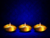 Oil lamp with place for diwali greetings over dark  background Royalty Free Stock Image
