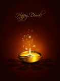 Oil lamp with place for diwali greetings over dark background Stock Photography