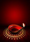 Oil lamp with place for diwali greetings over dark background Royalty Free Stock Photography