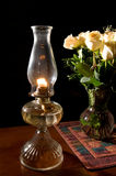 Oil lamp, with roses Royalty Free Stock Photos