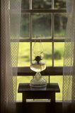 Oil lamp in window Stock Images