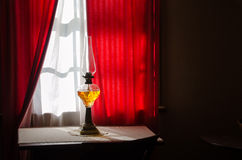 Oil lamp in window Royalty Free Stock Photos
